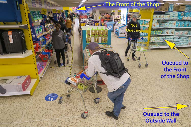 Coronavirus Outbreak - Queuing in Tesco's for the Checkout